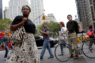 Passers-by paused on Sunday at 23rd Street and Fifth Avenue, about a block away from where an explosion occurred the previous night.