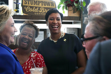 Hillary Clinton and Mayor Muriel E. Bowser, center, in the District of Columbia last month.