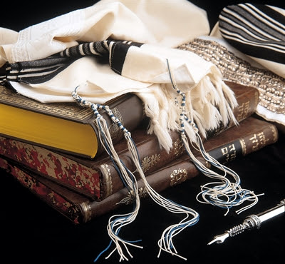 Hebrew holy books and             prayer shawl