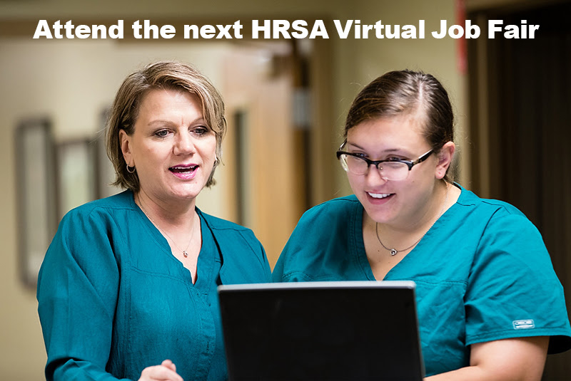 Two nurses talking and looking at computer