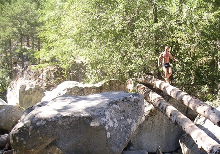 erwan walking across log
