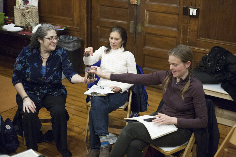 Rebecca Lurie, left, Margaret Rose de Cruz, center, and Helen Zuman share a chocolate treat at a Brooklyn Gift Circle meeting, where attendees offer up—and ask for—services and goods.