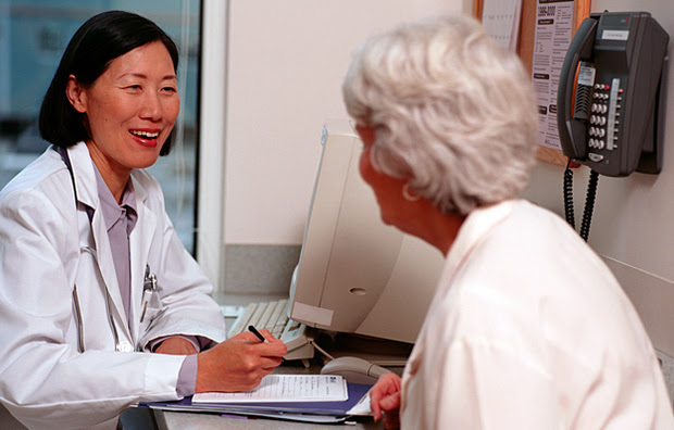 A senior woman consulting with a doctor.