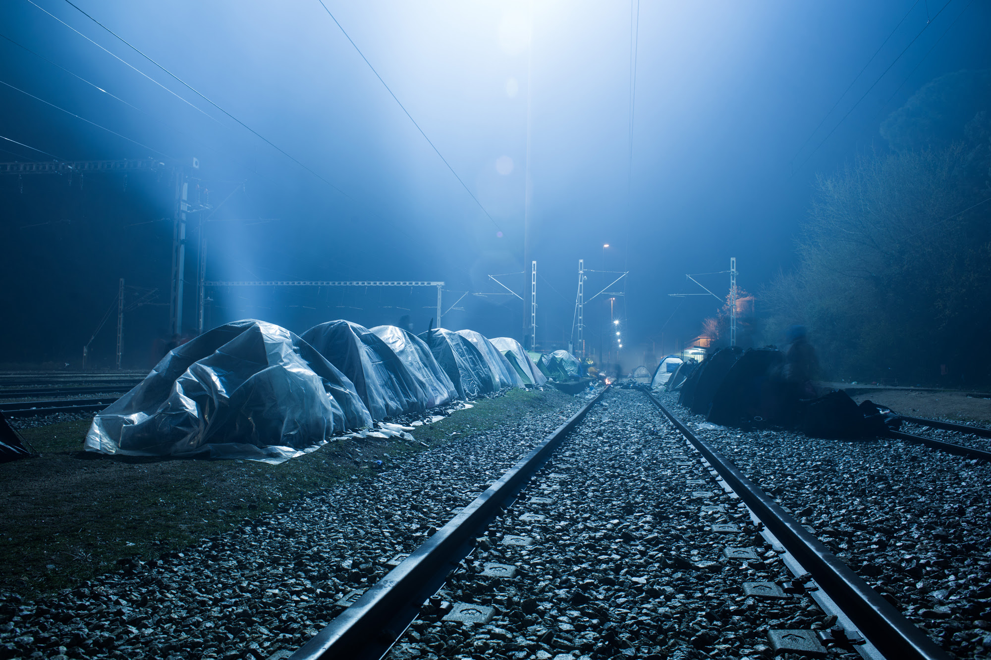 Photo by Stylianos Papardelas, occupied tents lining a railroad track