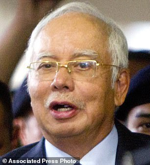 Former Malaysian Prime Minister Najib Razak is facing corruption charges. He is pictured leaving court in September