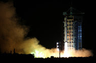 A rocket with the world's first quantum communications satellite lifting off from Jiuquan, in Gansu Province, on Tuesday.