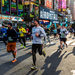 A pack of runners passed though Times Square on Sunday during the New York City Half Marathon.