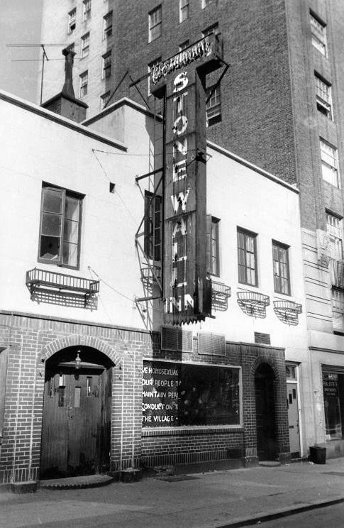 Black and white photo of the Stonewall Inn, taken during the Stonewall Riots