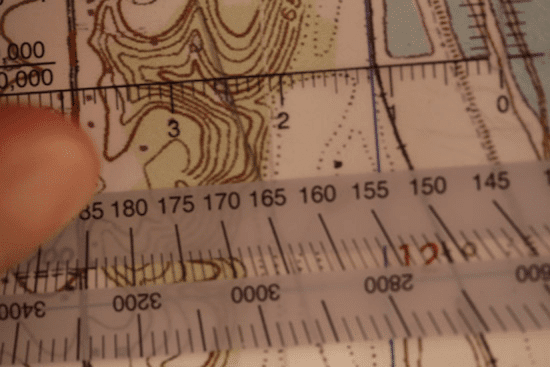 land navigation protractor lined up on topo topographic map