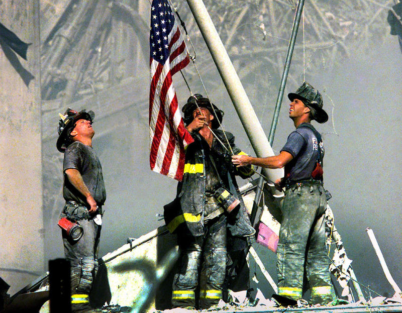 3 Firegighters Raise the Flag on 9-11