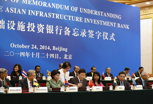 China's Finance Minister Lou Jiwei (C) signs a document, with the guests of the signing ceremony of the Asian Infrastructure Investment Bank at the Great Hall of the People in Beijing October 24, 2014 [Xinhua]