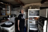Anna Kousoula, 60, in her kitchen in Perama, near Athens, in 2015. Capital controls were preventing her from withdrawing her widow's pension from the bank.