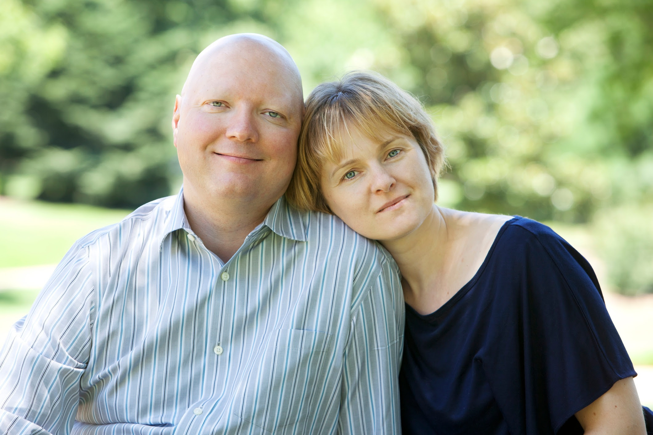 man with cancer being supported by his wife