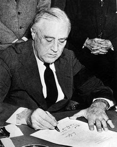 Franklin_Roosevelt_signing_declaration_of_war_against_Japan.jpg