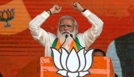 Indian Prime Minister Narendra Modi addresses a mass campaign rally this month, despite the COVID pandemic, on behalf of his Hindu nationalist Bharata Janata Party in Kolkata, India