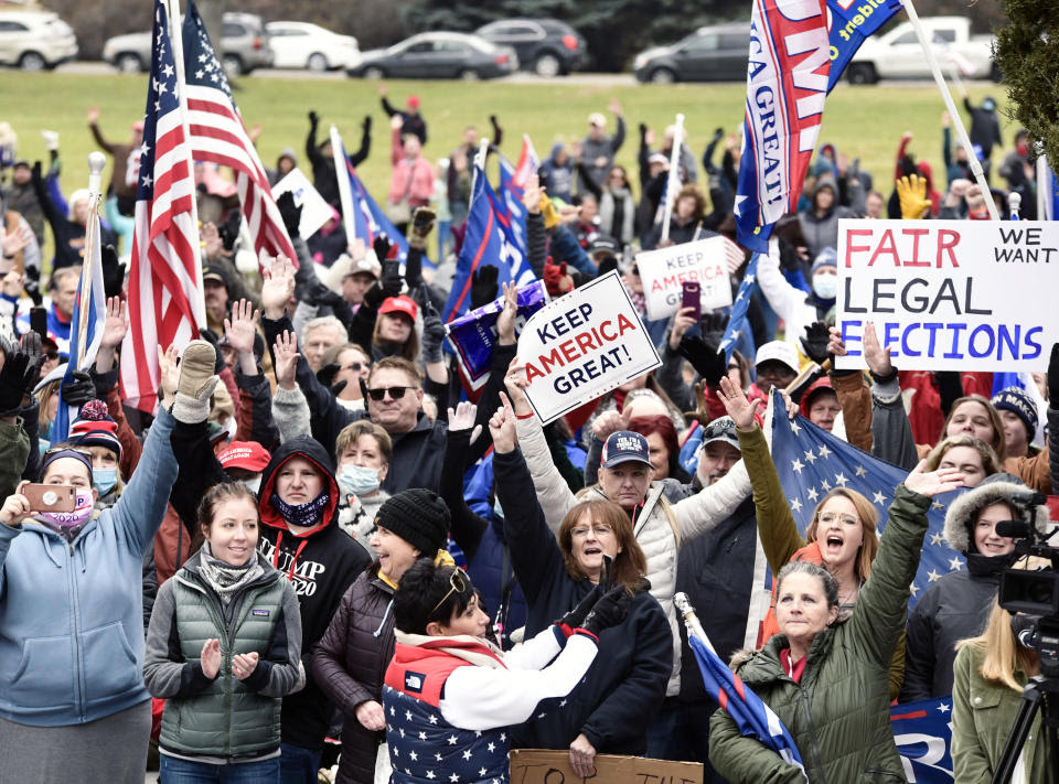 Supporters of President Trump gather for a rally at the steps of North Dakota State Library on the Capitol grounds in Bismarck, N.D., Saturday, Nov. 7, 2020. (Mike McCleary/The Bismarck Tribune via AP)