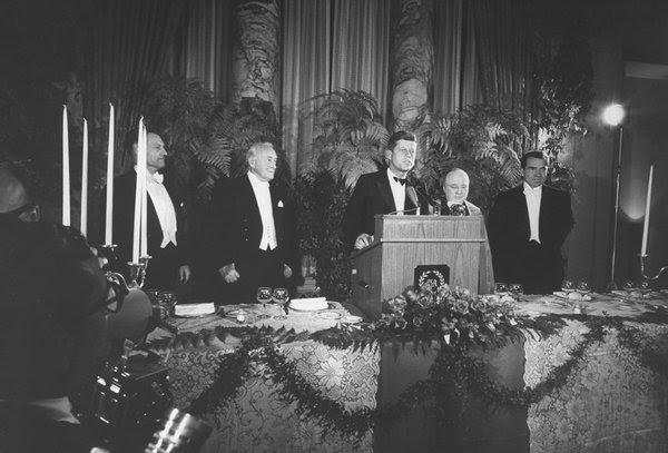 Senator John F. Kennedy, center, speaking at an Al Smith dinner.