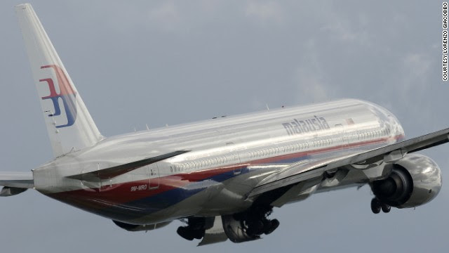 Lorenzo Giacobbo captured the now-missing Malaysia Airlines jet -- registration No. 9M-MRO -- flying into cloudy skies above Rome on January 30, 2011.