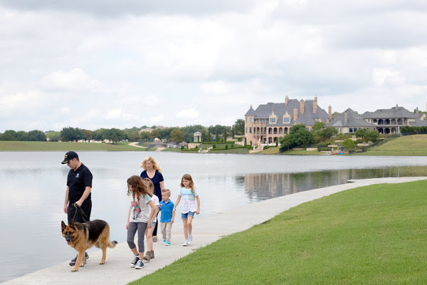 Paul and Brenda Chabot with their four children as they walked their dog around their new neighborhood in McKinney, Tex.