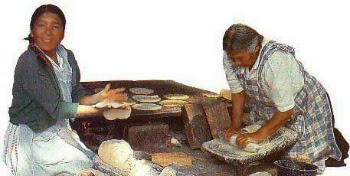 Native American's making tortillas