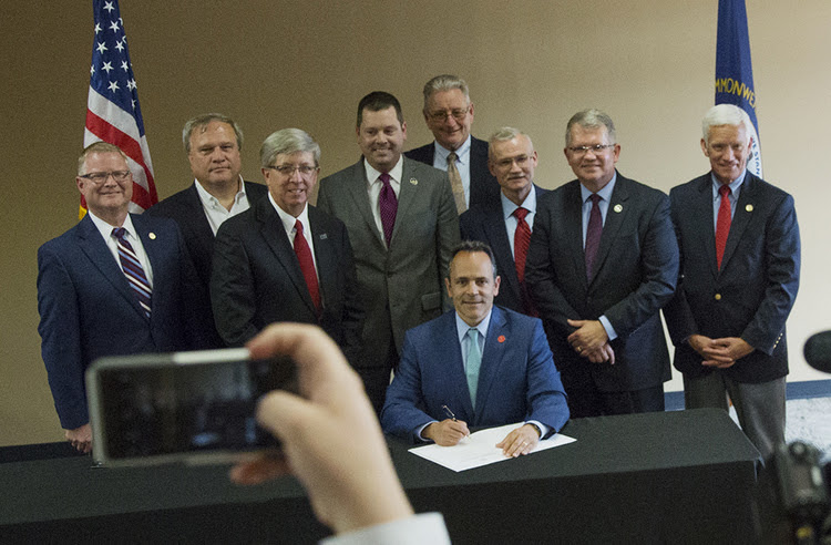 Gov. Matt Bevin (R-Ky.) signs Senate Bill 11, also known as the Leeper Act, at the Paducah Area Chamber of Commerce earlier this month. The legislation lifts the state&#39;s 33-year-old moratorium on nuclear power plant construction. (Ryan Hermens/The Paducah Sun via AP)</p>