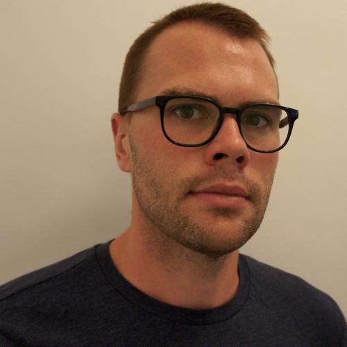 Samuel D. Hunter wearing glasses