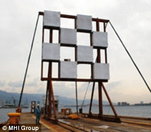 The test, which took place at Kobe Shipyard & Machinery Works in Nagoya, Japan, will help Jaxa devise its long-awaited space solar power system. Mitsubishi used microwaves to deliver 1.8 kilowatts of power - enough to run an electric kettle - through the air with pinpoint accuracy to a receiver (right) 170ft (55 metres) away
