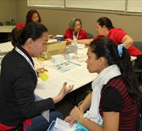 MRC volunteer provides health screening.