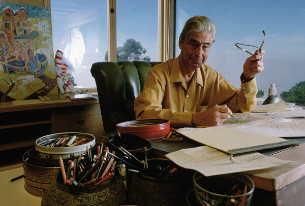 """Dr. Seuss Enterprises is pulling six of the author's books, saying they """"portray people in ways that are hurtful and wrong."""" Theodor Seuss Geisel, who wrote children's books as Dr. Seuss, is seen here in his La Jolla, Calif. home in 1957."""