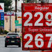 A sign in Pennsauken, N.J., last week displays gas prices that drivers have not seen in a long while. The price plunge is likely to reverberate as consumers spend the savings elsewhere.