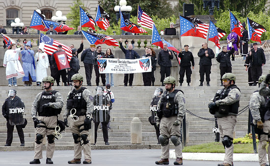 Th neo Nazi National Socialist Movement and the Loyal White Knights of the Ku Klux Klan rally at the North Carolina Capitol in April 2012. The same two groups are scheduled to gather at the South Carolina capitol on Saturday July 18, 2105.