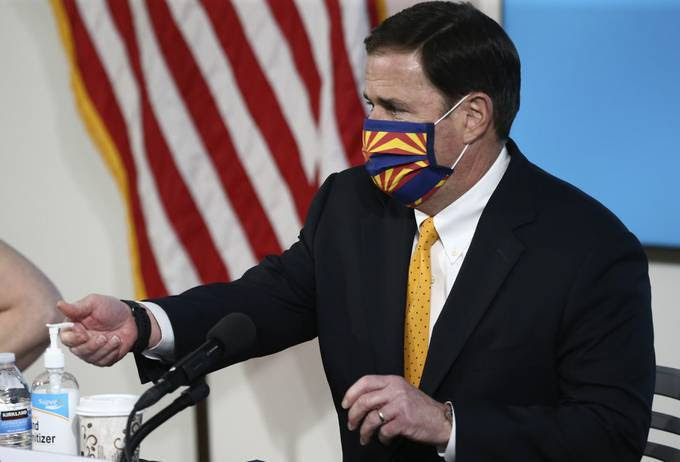 Arizona Gov. Doug Ducey (R) gives a coronavirus update at a news conference. (Ross Franklin/AP)