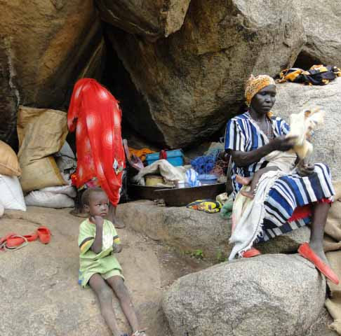 Thousands of Nuba                                                 Mountain civilians have                                                 taken from government                                                 bombing in caves                                                 (Diocese of El Obeid                                                 photo)