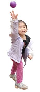 Child throwing ball