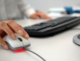 Womans hand using mouse