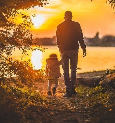 Dad walking with daughter