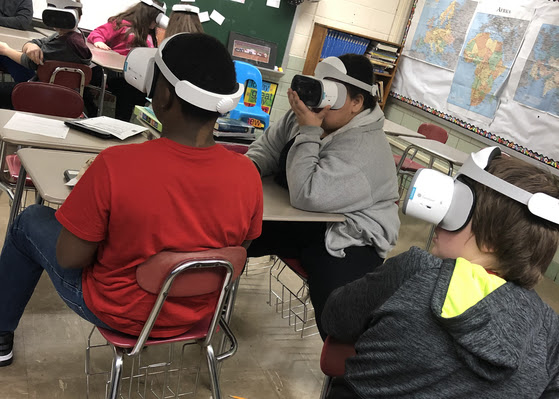 More students wearing VR goggles