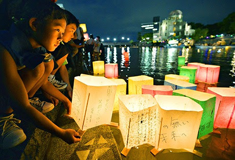 People release paper lanterns on the Motoyasu river