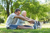 Caucasian Couple Stretching and Smiling