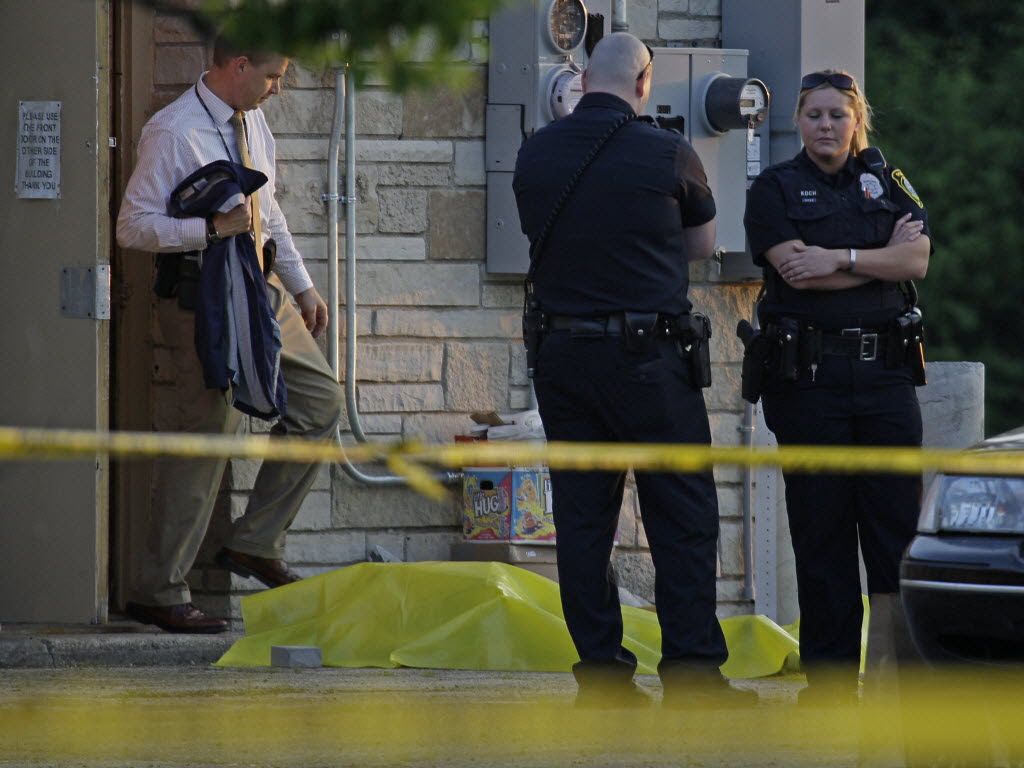 1036364 bytes; 3000 x 2252; Milwaukee Police officers investigate a homicide Wednesday near 8300 W. Silver Spring. Jeffrey Phelp