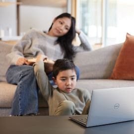 Child using a PC at home.