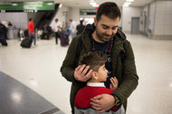 Haider Alshawi, an Iraqi man who was detained at Kennedy International Airport in New York on Saturday night, flew on Sunday to Houston, where he was greeted by his son.