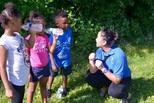 Summer intern talking with children