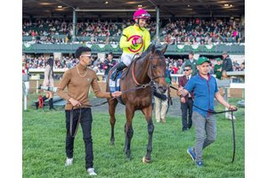 Shantisara and Flavien Prat head in for the win photo after taking the Queen Elizabeth II Challenge Cup Stakes at Keeneland