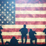 37916062-soldiers-in-assault-on-grunge-usa-flag-american-army-military-concept-stock-photo