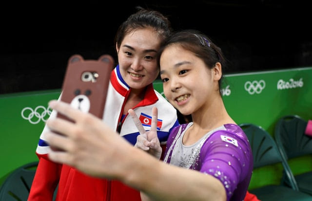 2016 Rio Olympics - Gymnastics trainingREFILE - CORRECTING ID OF SOUTH KOREAN ATHLETE 2016 Rio Olympics - Gymnastics training - Rio Olympic Arena - Rio de Janeiro, Brazil - 04/08/2016. Lee Eun-Ju (KOR) of South Korea (R) takes a selfie picture with Hong Un Jong (PRK) of North Korea. REUTERS/Dylan Martinez TPX IMAGES OF THE DAY. FOR EDITORIAL USE ONLY. NOT FOR SALE FOR MARKETING OR ADVERTISING CAMPAIGNS.