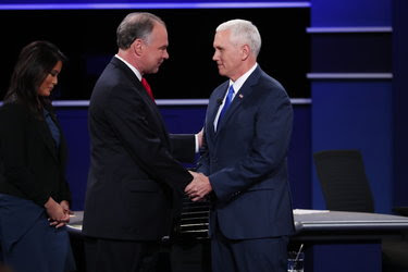 Senator Tim Kaine and Gov. Mike Pence, with the moderator Elaine Quijano, at the start of the vice-presidential debate on Tuesday.