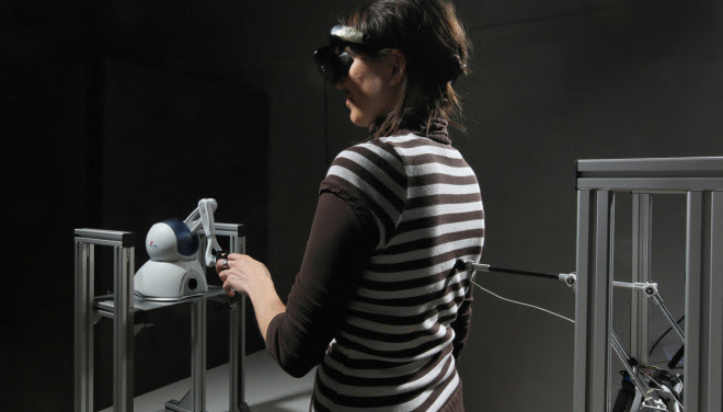 This robot causes people to experience the illusory sensation of someone standing behind them.