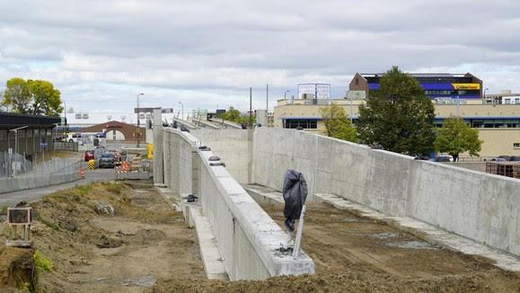 Royalston Avenue: LRT bridge and retaining wall structure.