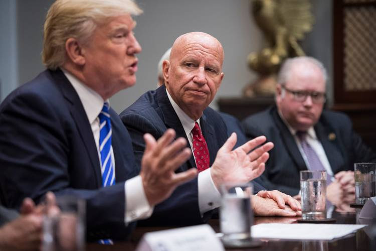 Rep. Kevin Brady (R-Tex.) listens as President Trump speaks to members of the House Ways and Means Committee at the White House. (Jabin Botsford/The Washington Post)